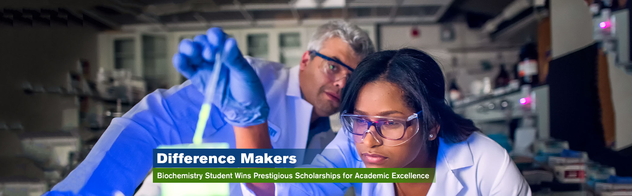 Banner image of Lehman College Biochemistry student and professor working in the lab.