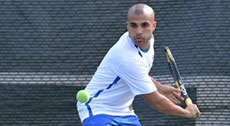 Photo of Tennis Player in front of APEX