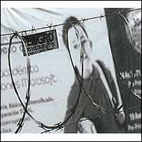 photo of woman behind barbed wire