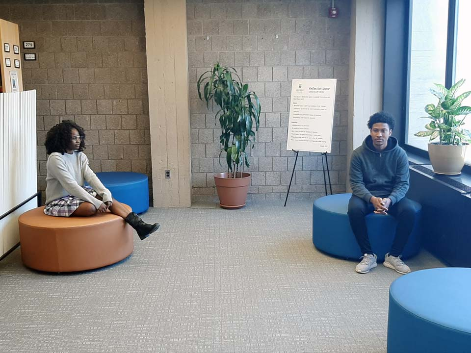 Photo of Lehman Students in Leonard Lief Library