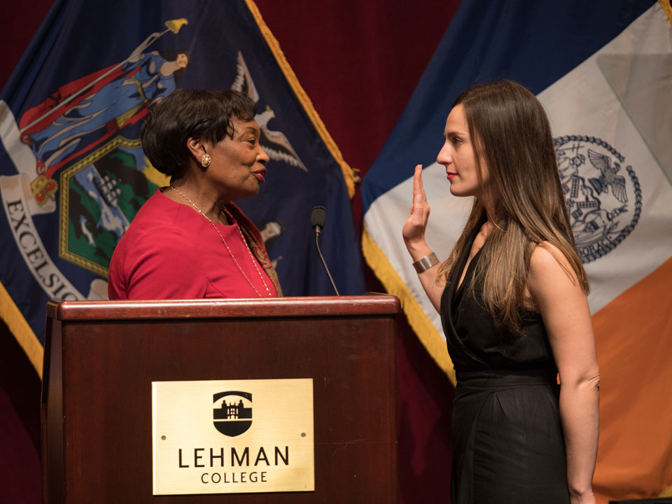 Photo of NY State Senator Alessandra Biaggi being sworn in at Lehman College by State senator and  majority conference leader Andrea Stewart-Cousins